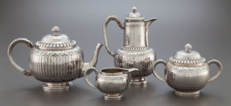 68022: A FOUR PIECE ODIOT FRENCH SILVER TEA AND COFFEE