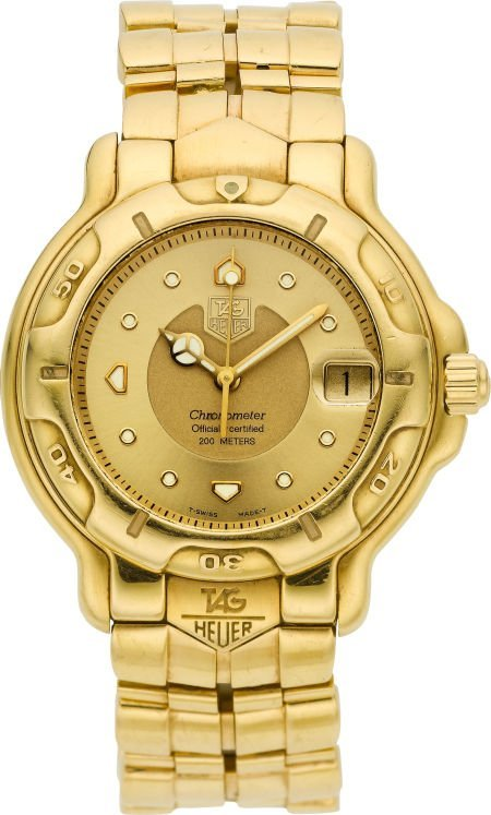 61013: Tag Heuer WH514 Gent's Massive 18k Gold Automati