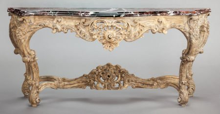 62001: A FRENCH RÉGENCE-STYLE CARVED GILT WOOD CONSOLE