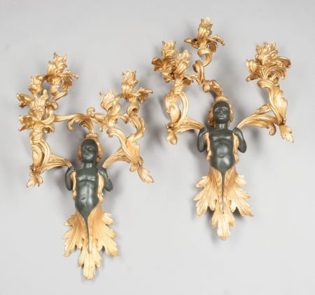 62009: A PAIR OF LOUIS XV-STYLE GILT AND PATINATED BRON
