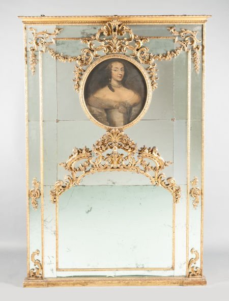 62014: A FRENCH LOUIS XV-STYLE CARVED GILT WOOD MIRROR
