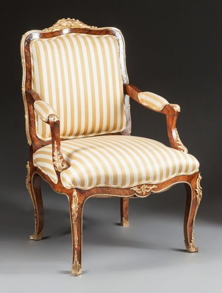 62023: A LOUIS XV-STYLE MAHOGANY AND GILT BRONZE UPHOLS