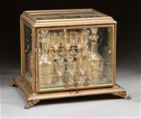 A TWENTY PIECE FRENCH GLASS AND GILT BRONZE CAVE