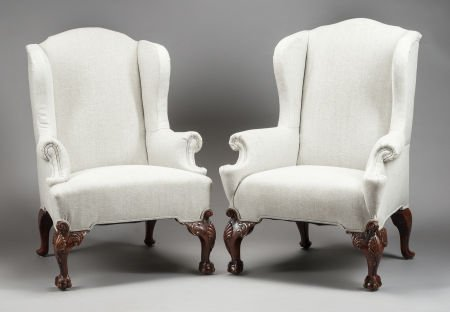 62560: A PAIR OF IRISH MAHOGANY AND UPHOLSTERED WING CH