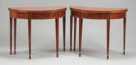 62562: A PAIR OF GEORGIAN MAHOGANY DEMILUNE GAME TABLES