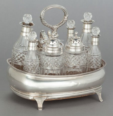 62563: A NINE PIECE HAYTER SILVER AND GLASS CRUET SET