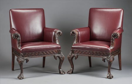 62568: A PAIR OF IRISH MAHOGANY AND LEATHER UPHOLSTERED