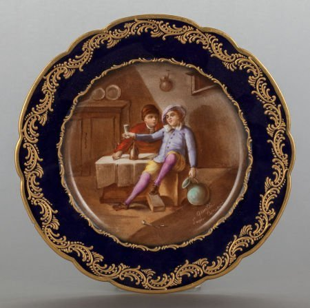 62852: A FRENCH PAINTED PORCELAIN PLATE WITH GENRE SCEN