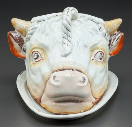 62861: A STAFFORDSHIRE CERAMIC COW-FORM CHEESE PLATE Ea