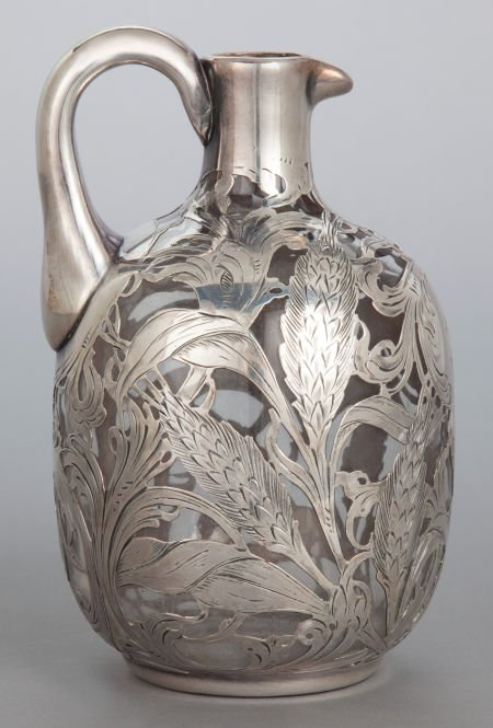 62866: A CLEAR GLASS AND SILVER OVERLAID PITCHER 20th c