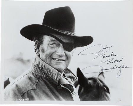 46144: A John Wayne Signed Black and White Photograph,