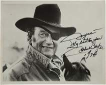 46145 A John Wayne Signed Black and White Photograph