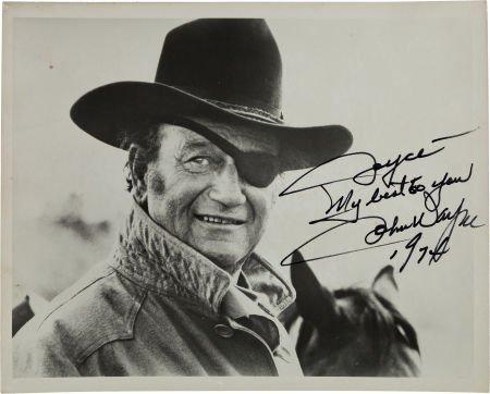 46145: A John Wayne Signed Black and White Photograph,