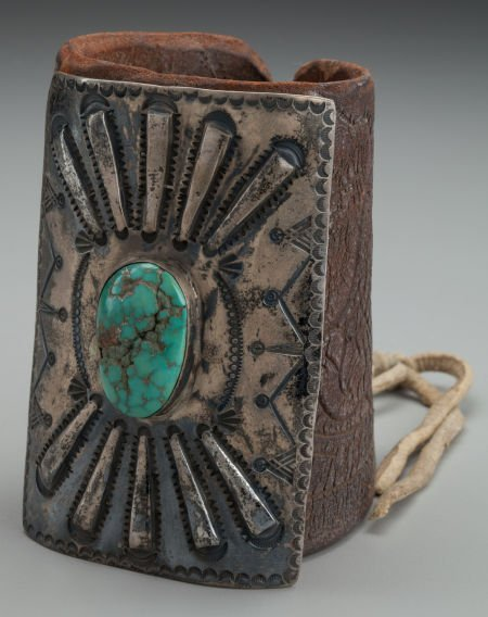 71018: A NAVAJO SILVER AND TURQUOISE BOW GUARD c. 1930