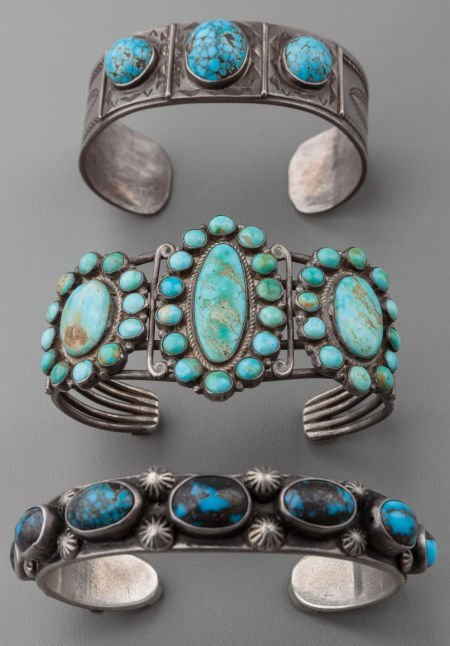 71021: THREE SOUTHWEST SILVER AND TURQUOISE BRACELETS c