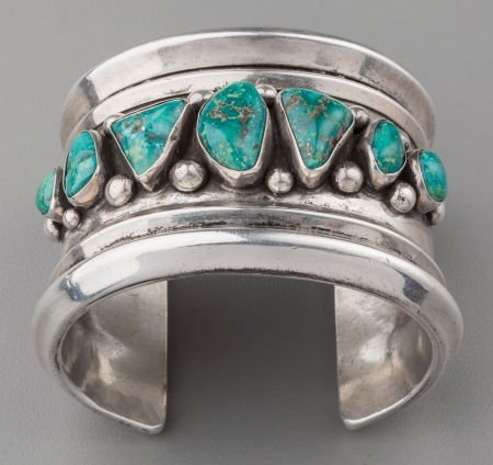 71024: A COCHITI SILVER AND TURQUOISE BRACELET Joe Quin