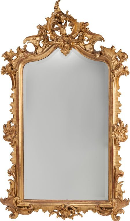 62301: A LOUIS XV-STYLE CARVED GILTWOOD MIRROR, circa 1
