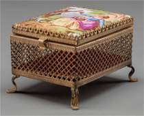 63212 A SMALL FRENCH PORCELAIN AND GILT BRONZE MIRRORE