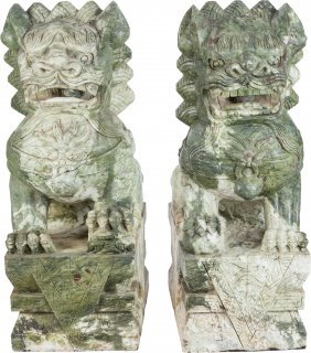 A Large Pair Of Chinese Carved Hardstone Foo Dog
