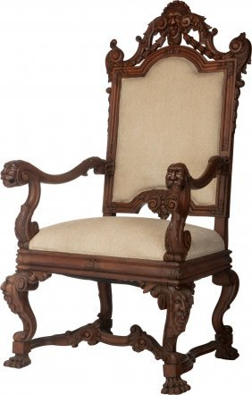 A Continental Carved Oak And Upholstered Armchai