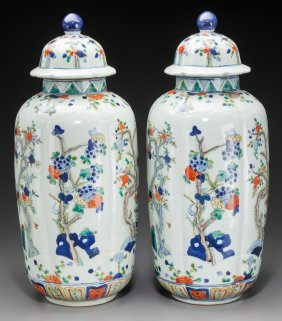 A Pair Of Chinese Polychrome Porcelain Covered U