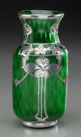 A Quilted Green Glass Vase With La Pierre Silver