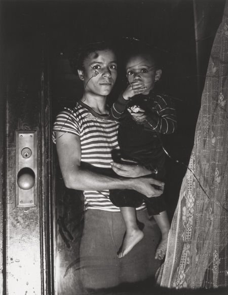 73097: Weegee (American, 1899-1968) Mother and Child, H