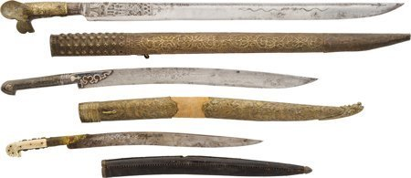 40022: Lot of Three Middle Eastern Yataghan Style Sword