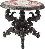 61091: A Renaissance Revival Carved Oak Center Table wi