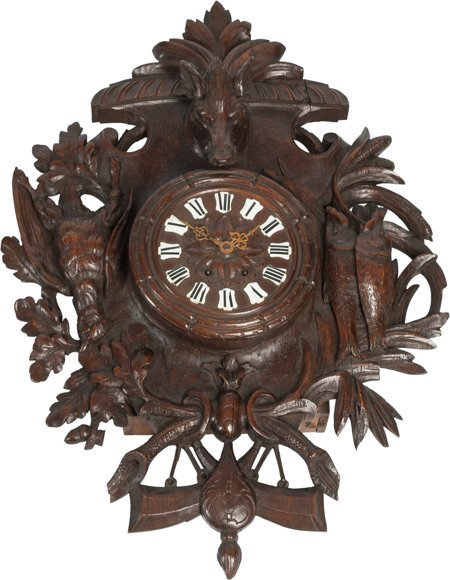 61049: A Black Forest Carved Figural Wall Clock 32 h x