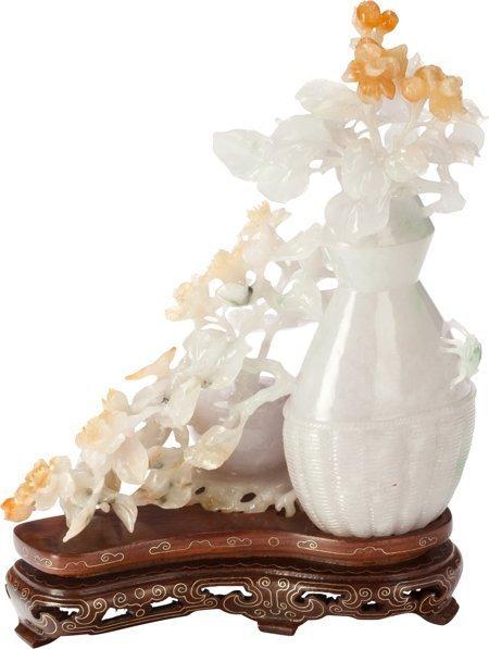 61403: A Chinese Carved Jadeite Floral Lidded Vase on S