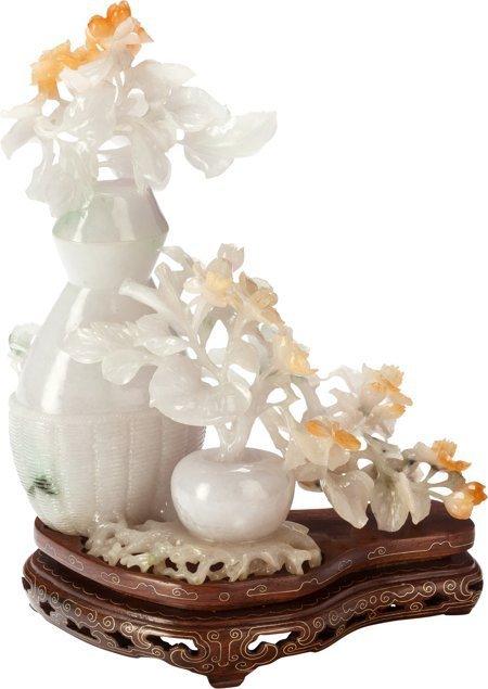 61403: A Chinese Carved Jadeite Floral Lidded Vase on S - 2