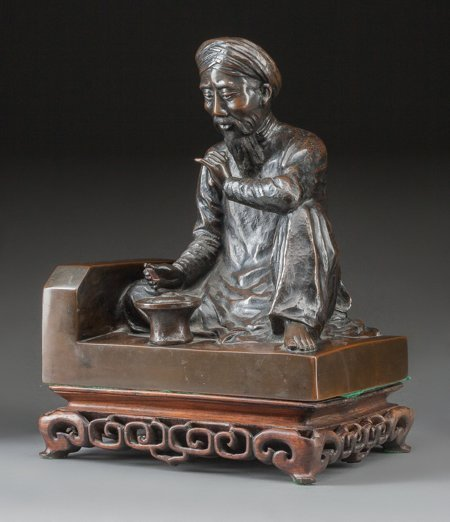61418: A Japanese Patinated Bronze Seated Man with Wood