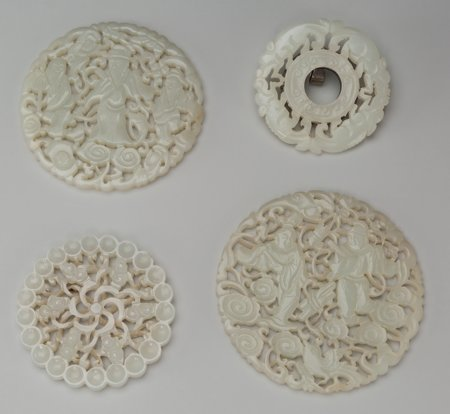 61934: A Group of Four Chinese Carved Jade Disks 3-1/4