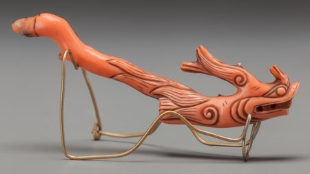 61937: A Chinese Carved Coral Hair Pin with Stand: Drag