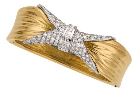 55018: Diamond, Gold Bracelet  The hinged bangle featur