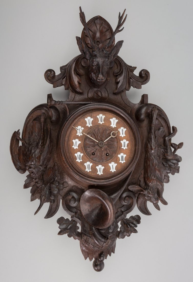 65003: A Black Forest Carved Walnut Wall Clock, late 19