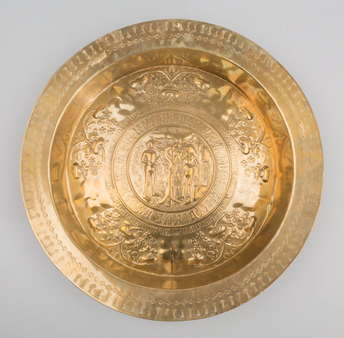 65023: A Large Nuremberg Brass Alms Dish: Adam and Eve,