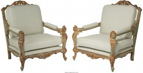 61183: A Pair of Italian Painted and Partial Gilt Carve
