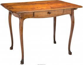 61687: A French Provincial Louis XV-Style Carved Walnut
