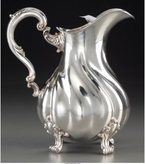61881: A Silver Water Pitcher with Ice Guard Insert Des