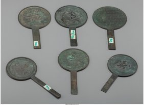 61848: A Group of Six Small Japanese Bronze Hand Mirror