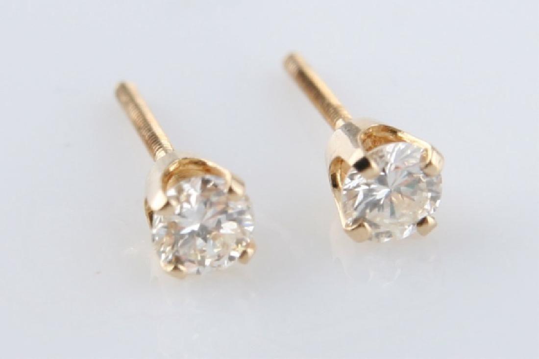 Pair of 14k Yellow Gold Diamond Stud Earrings