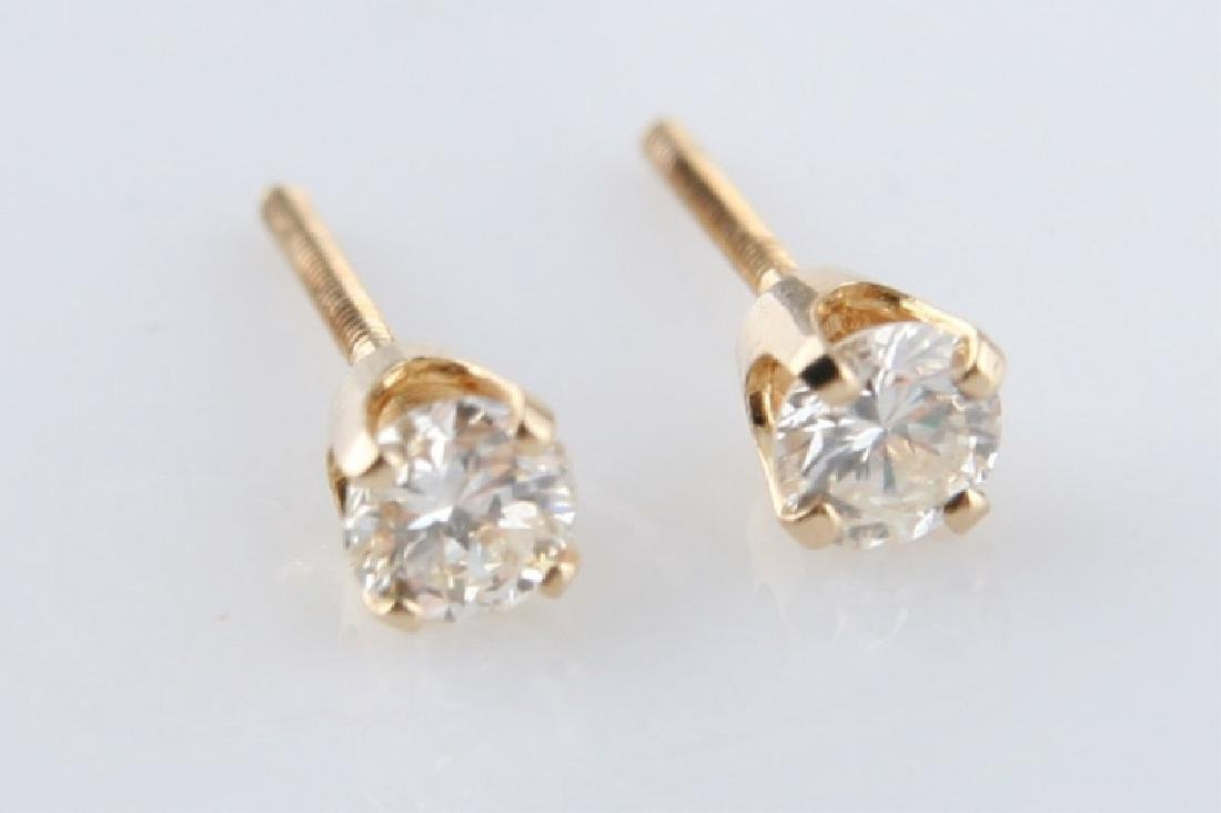 Pair of 14k Yellow Gold Diamond Stud Earrings