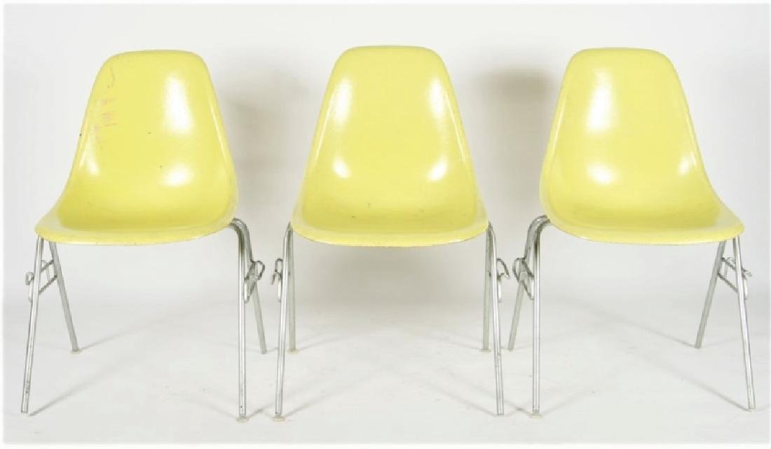 Three Yellow Herman Miller DSS Stacking Chairs