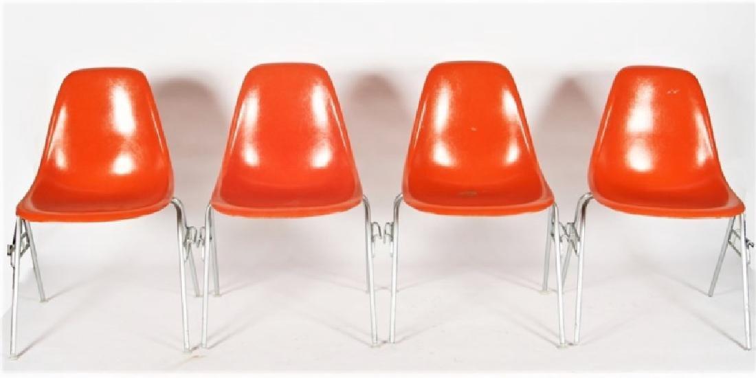Four Orange Herman Miller DSS Stacking Chairs