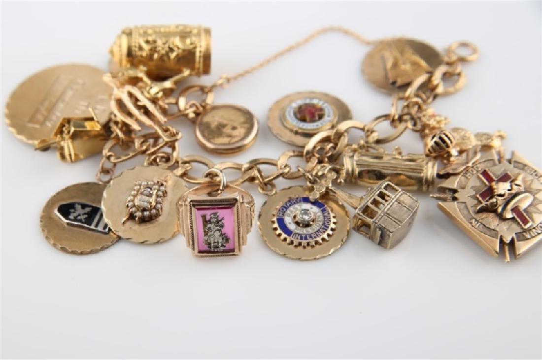 14kt Yellow Gold Lady's Charm Bracelet - 4