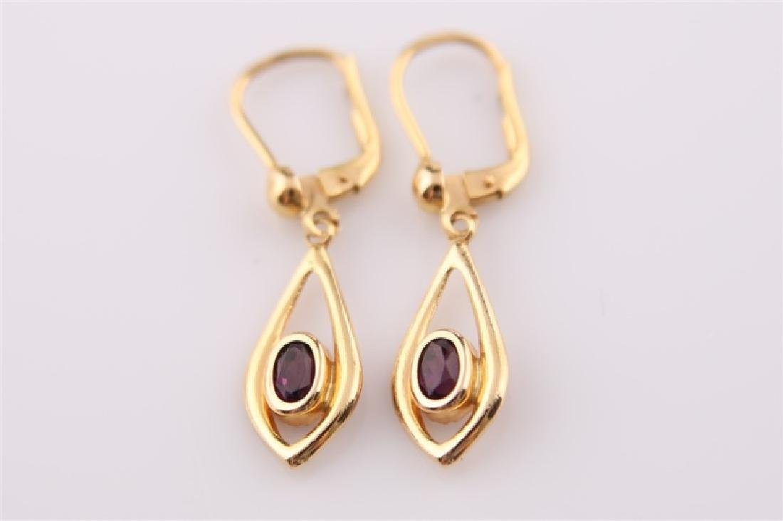 Pair of 18kt Yellow Gold and Amethyst Earrings
