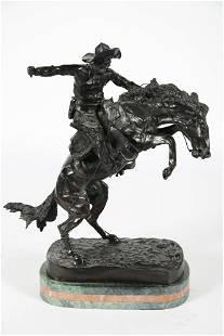 "After Remington, ""Bronco Buster"" Bronze Sculpture"