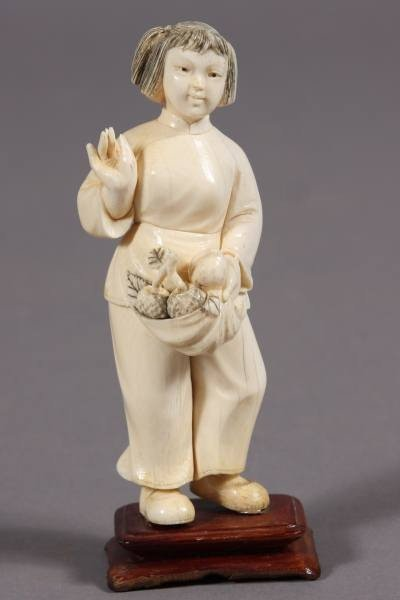 15: Carved Ivory Figure of a Girl with Apron of Fruit